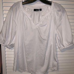 Small white 3/4 sleeve blouse. Split v neck